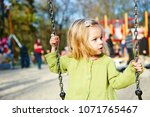little child blond girl having... | Shutterstock . vector #1071765467