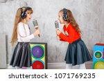 two little girls the children... | Shutterstock . vector #1071769235