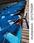 Small photo of Row boats in a Row