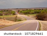A highway traversing an agriculture area in the Oklahoma panhandle.