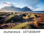unique view on green hills with ... | Shutterstock . vector #1071838349