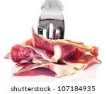 closeup of a pile of spanish serrano ham on a fork - stock photo