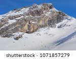 a wintertime view on mt. titlis ... | Shutterstock . vector #1071857279