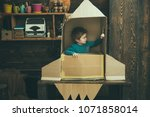 kid sit in cardboard hand made...   Shutterstock . vector #1071858014