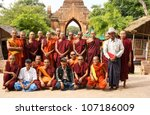 BAGAN, MYANMAR - NOV 17: An unidentified group of buddhist monks are posing during a study trip around the ancient temples of Bagan on Nov 17, 2011 in Bagan, Myanmar - stock photo