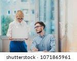 supervisor giving feedback to... | Shutterstock . vector #1071865961