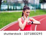 female runner looking at her...   Shutterstock . vector #1071883295