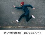 hipster man runs in the air... | Shutterstock . vector #1071887744