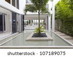palm tree and fountain inside... | Shutterstock . vector #107189075