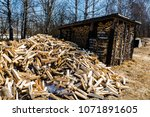 chopped firewood. large... | Shutterstock . vector #1071891605
