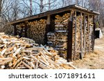 chopped firewood. large... | Shutterstock . vector #1071891611