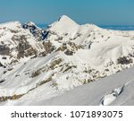 a wintertime view on mt. titlis ... | Shutterstock . vector #1071893075