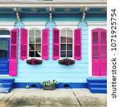 colorful house in new orleans ... | Shutterstock . vector #1071925754
