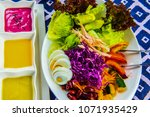 chicken salad with dressing on... | Shutterstock . vector #1071935429