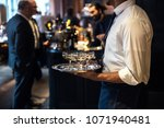 waiter from catering service... | Shutterstock . vector #1071940481