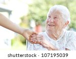 Happy Senior Woman Holding...