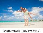 closeup of happy young... | Shutterstock . vector #1071955919