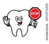 cartoon tooth character holding ... | Shutterstock .eps vector #1071971525