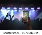female hand holding mobile... | Shutterstock . vector #1072002245