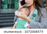 close up business woman talking ... | Shutterstock . vector #1072008575