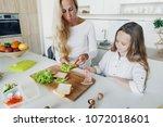 mother with daughter preparing... | Shutterstock . vector #1072018601