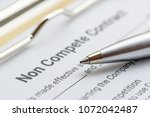 blue pen and a non compete... | Shutterstock . vector #1072042487