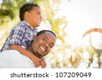 happy mixed race father and son ... | Shutterstock . vector #107209049