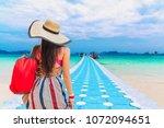 traveler woman standing on sea... | Shutterstock . vector #1072094651