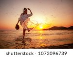 woman enjoying beautiful sunset ... | Shutterstock . vector #1072096739