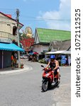 Small photo of Koh Samui, Thailand - April 3, 2018: Scooter hire is a popular way to get around the island and will allow you to reach popular landmarks such as the big Buddha statue.