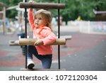 portrait of a little girl... | Shutterstock . vector #1072120304