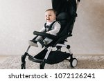 little smiled boy sits in the...   Shutterstock . vector #1072126241