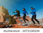 three friends jumping happy in... | Shutterstock . vector #1072130234