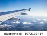 view from the airplane over... | Shutterstock . vector #1072131419