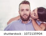 portrait of happy young couple  ... | Shutterstock . vector #1072135904