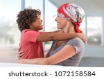 happy ill mother kissing her...   Shutterstock . vector #1072158584