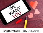 Small photo of Writing note showing We Want You. Business photo showcasing Employee Help Wanted Workers Recruitment Headhunting Employment written Mobile Phone Screen wooden background Pen and Hearts
