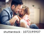 father and daughter playing... | Shutterstock . vector #1072195937