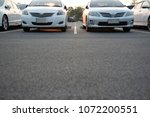 cars parked in the parking lot. ... | Shutterstock . vector #1072200551