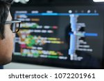 programmer checking code on... | Shutterstock . vector #1072201961