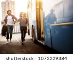 young couple is rushing to... | Shutterstock . vector #1072229384