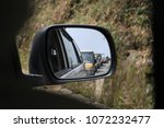 reflection of travelling cars... | Shutterstock . vector #1072232477