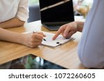 realtor talk with client.  real ... | Shutterstock . vector #1072260605