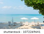 beach chairs with umbrella with ...   Shutterstock . vector #1072269641