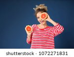 cute young woman with halves of ... | Shutterstock . vector #1072271831