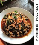 Small photo of Thai e-san food dishes, Fried Snails with Basil, Chilli, local food of Northeastern Thailand, Farmland, Fish, delicious, Pond snail, Marsh snail, River snail