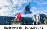 French Flags Flying In Front Of ...