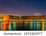 night view of illuminated... | Shutterstock . vector #1072302977