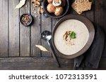 mushroom cream soup in a bowl... | Shutterstock . vector #1072313591