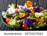 summer salad of edible flowers... | Shutterstock . vector #1072327031